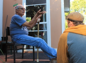 John Laurits conversing with Andy Laverdure, photo by Jacob Yona